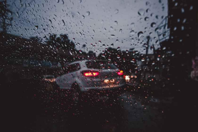 silver suv on asphalt road during rain